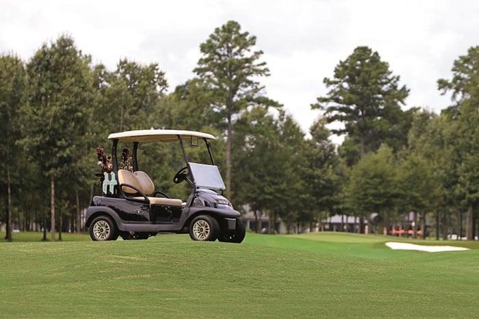 A golf car on a field.