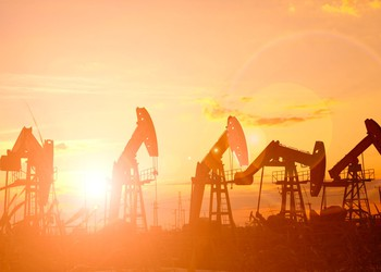 Multiple oil pumps at sunrise