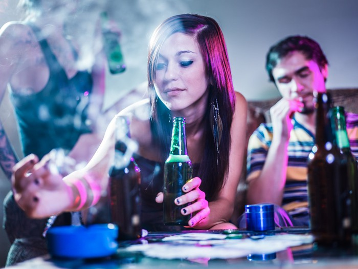 Couple smoking marijuana and drinking beer