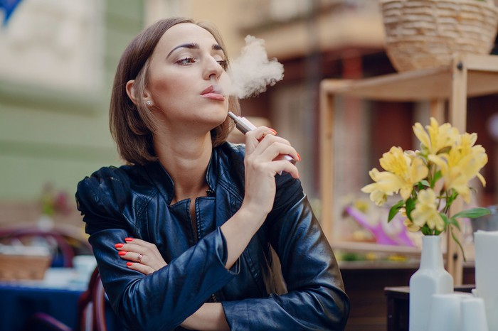 Woman using a personal vaping device