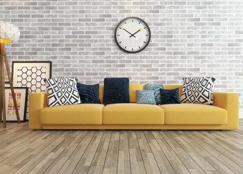 Living Room Wood Flooring, Couch, and Large Wall Clock