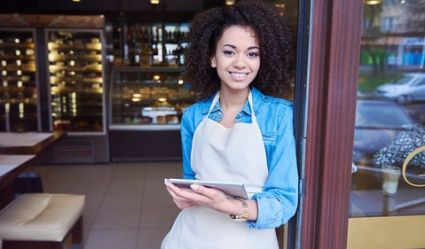 Small Business Owner at Shopfront With Tablet