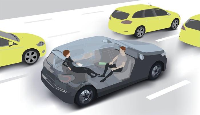 A driveless car cruises down a highway.