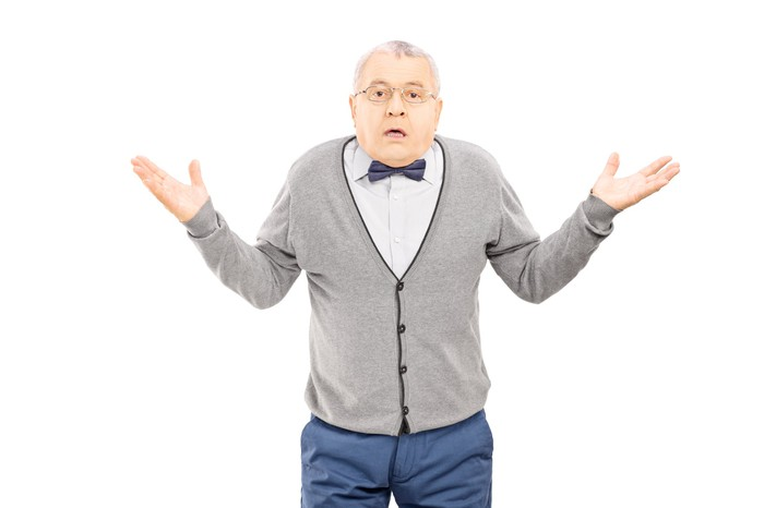 A retiree in a bow tie shrugging his shoulders.