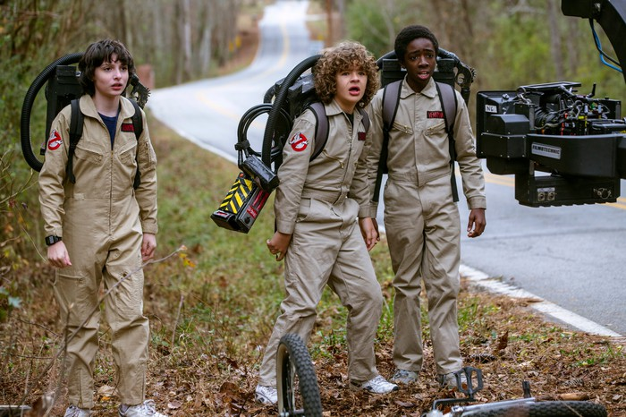 Filming of Netflix original Stranger Things 2, with three young actors dressed as Ghostbuster's characters.