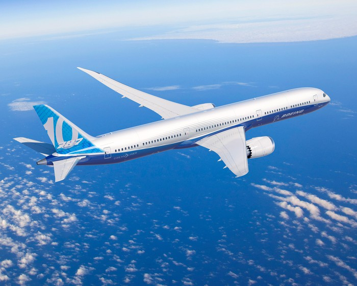 A rendering of a 787-10 Dreamliner flying over water
