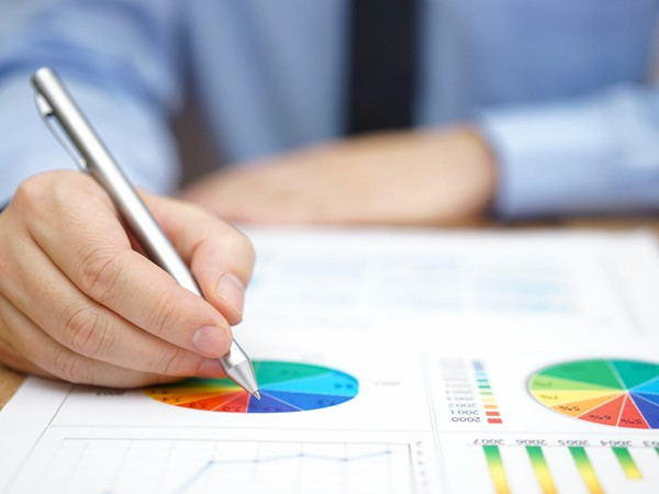 man writing on pie chart_GettyImages-465430578