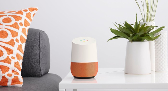 A Google Home device on a side table.