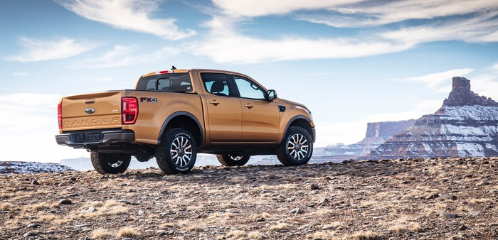 The 2019 Ford Ranger pickup viewed from a rear three-quarter angle, on a desert landscape.