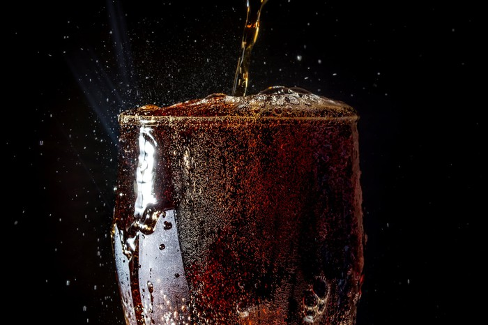 Soda pouring into a glass