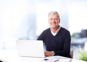 senior man at a laptop_GettyImages-511919912