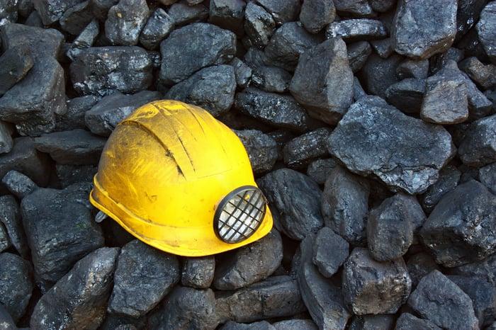 a coal miners helmet on some coal