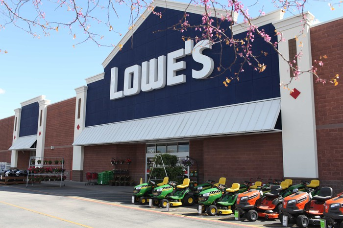 The storefront of a Lowe's Companies location as viewed from the front parking lot.