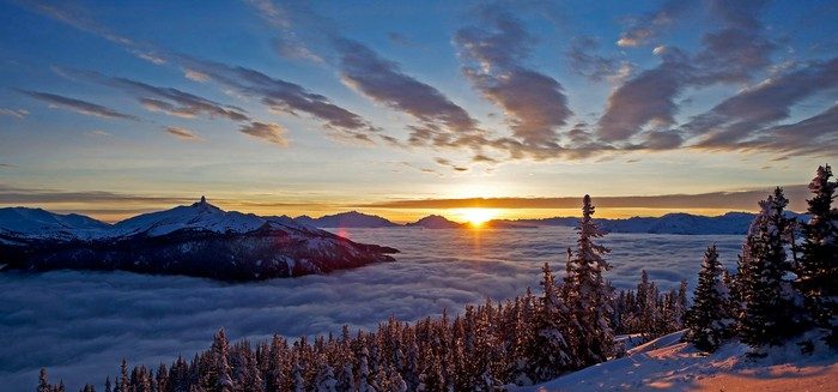 A sunrise over mountains.