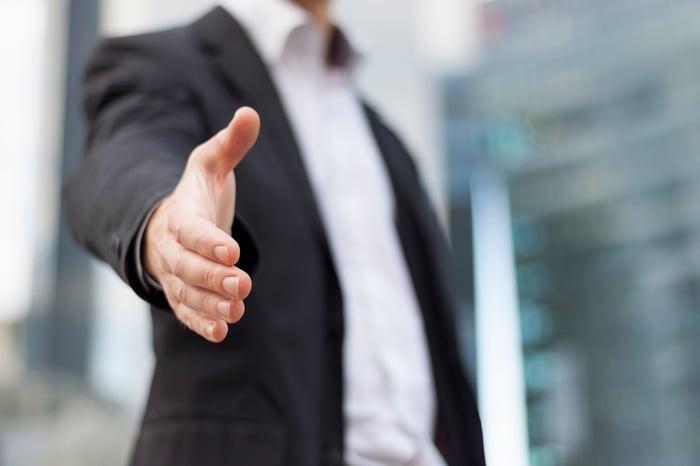 Professional extending a handshake