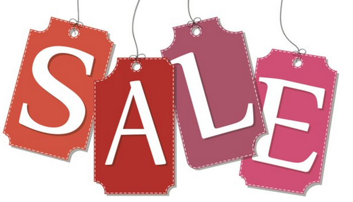 Hanging tags with letters on them spell out the word sale.