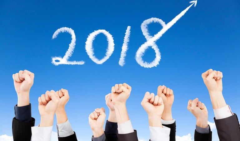 2018 in sky with fists raised