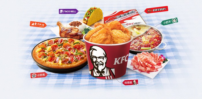 Various menu items from Yum China's restaurant chains arranged on a table