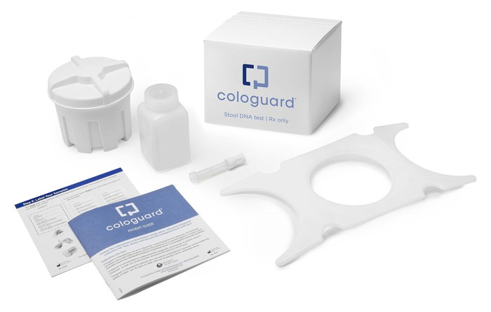 Cologuard test materials, including instructions, sample storage unit, and shipment box.