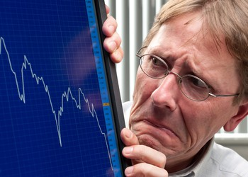 Man Worried About Sinking Stock Market Chart Getty