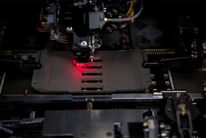 Laser being used in industrial manufacturing equipment