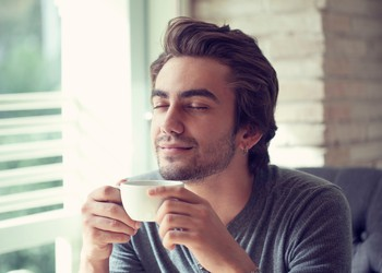 man enjoying a cup of coffee_GettyImages-493107030
