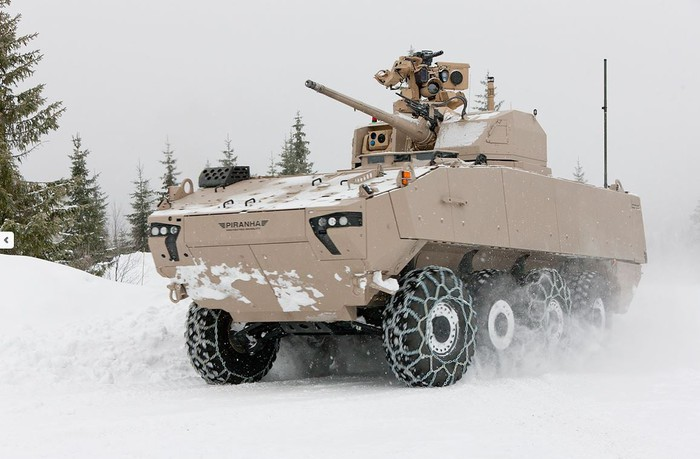 Piranha V armored personnel carrier driving through snow