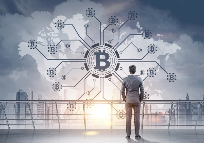 Businessman looking at a bitcoin network