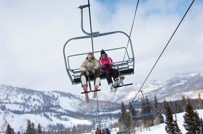 A couple riding a ski lift