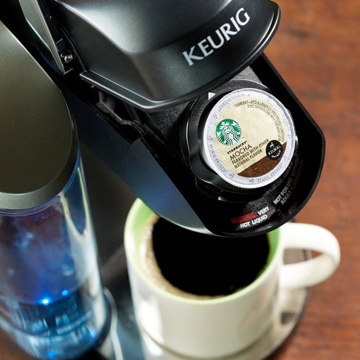 A Starbucks K-Cup pod in a Keurig machine