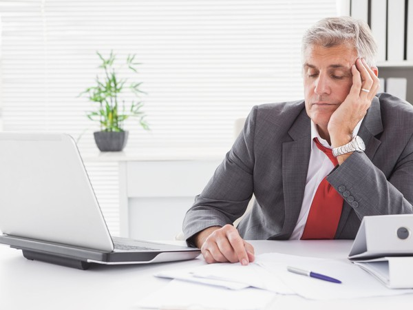 man falling asleep at desk_GettyImages-526981157