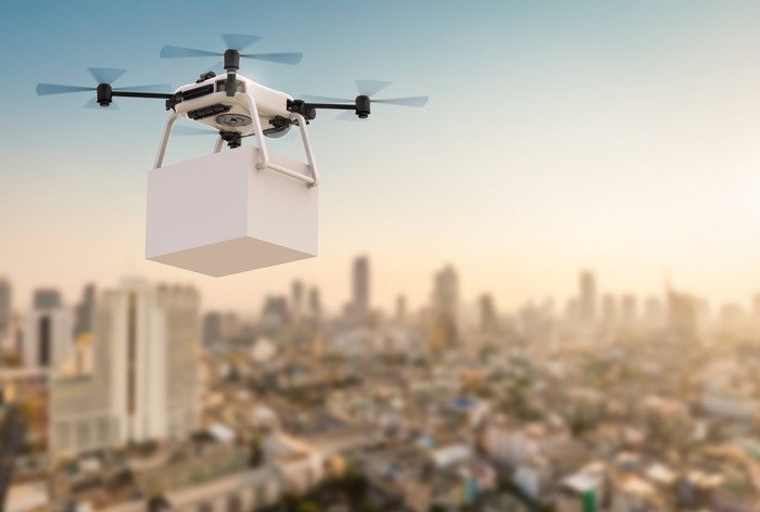 A delivery drone flying over a city.