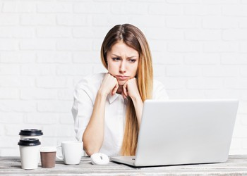 woman at a laptop looking sad_GettyImages-511733684