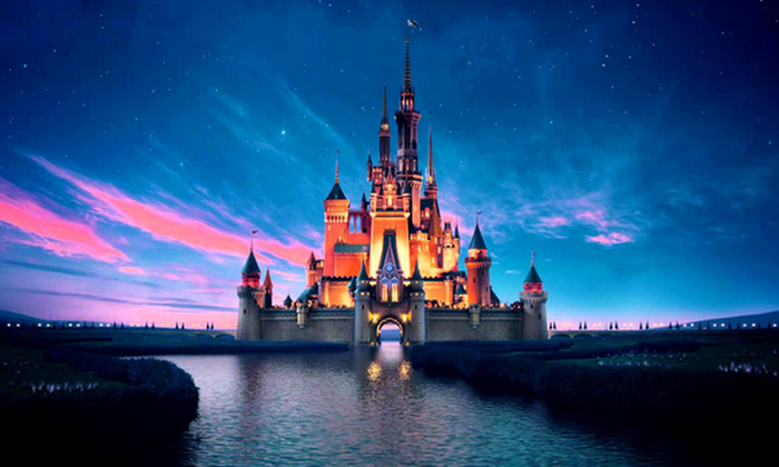 View of Cinderella's Castle at Disney World at dawn or dusk.
