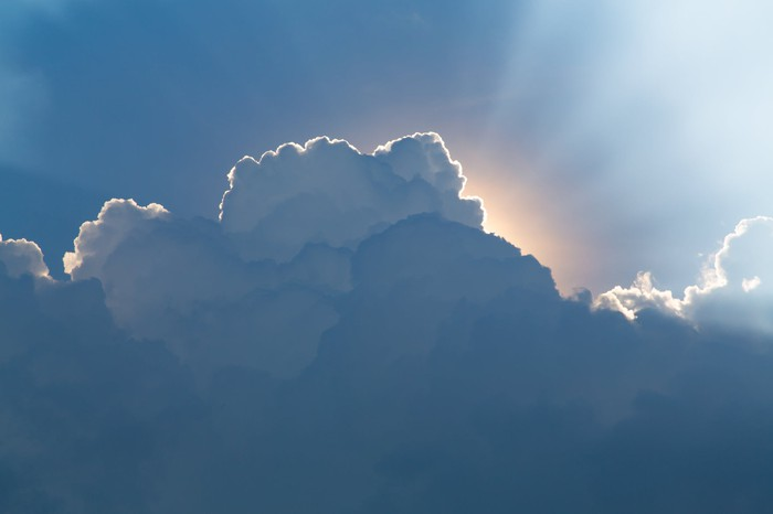 Rays of light emanating from behind a cloud.