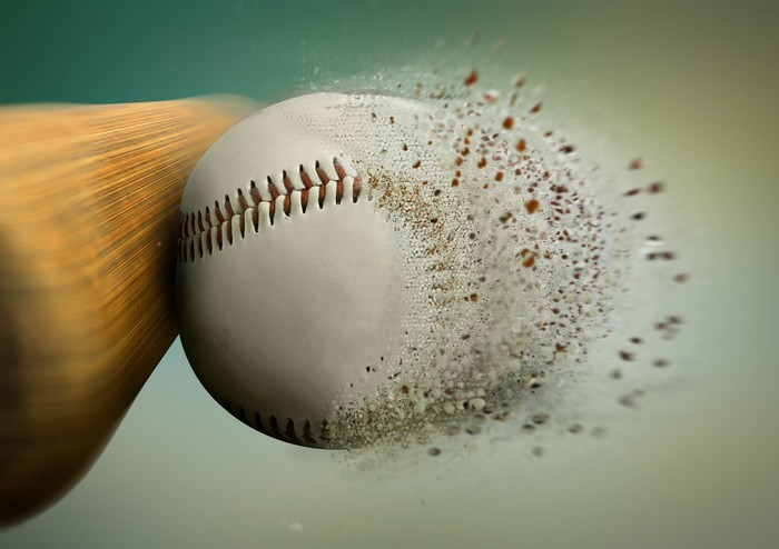 A bat crushing a baseball
