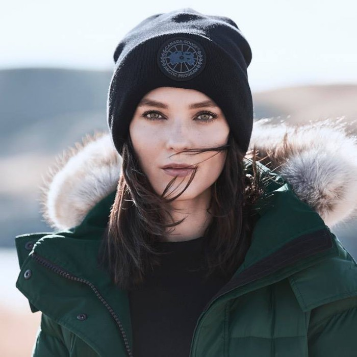 Lady with a Canada Goose hat and coat on.