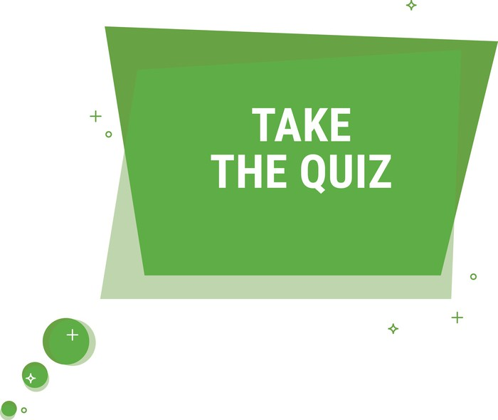 green geometric shape on which is printed take the quiz