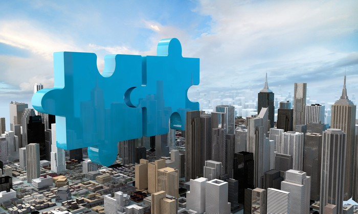 Two giant puzzle pieces placed in a city landscape.