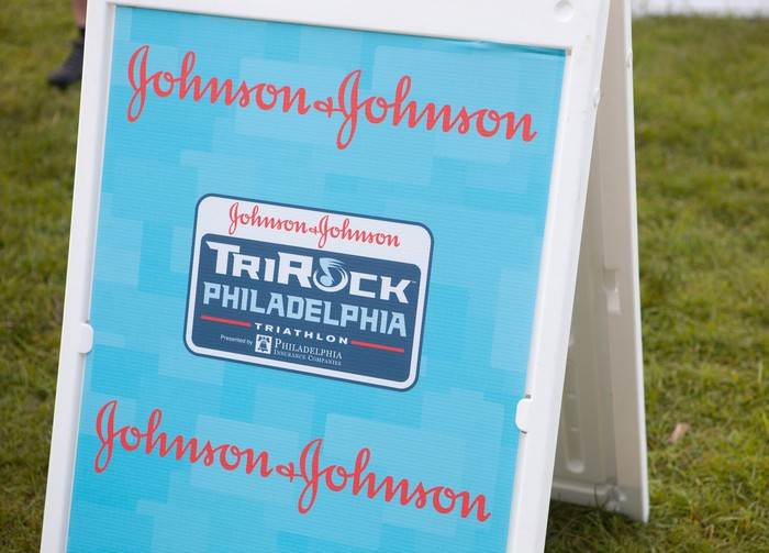 Sign at TriRock Philadelphia triathlon showing Johnson & Johnson sponsorship.