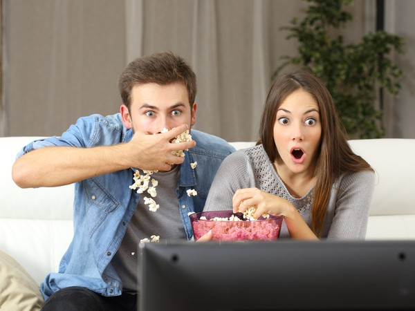 AG excited couple watching TV