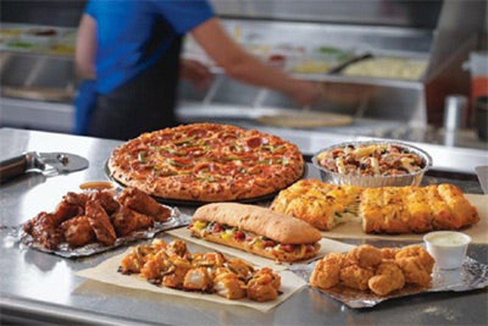 A display of Domino's menu items including pizza, chicken wings, and breadsticks