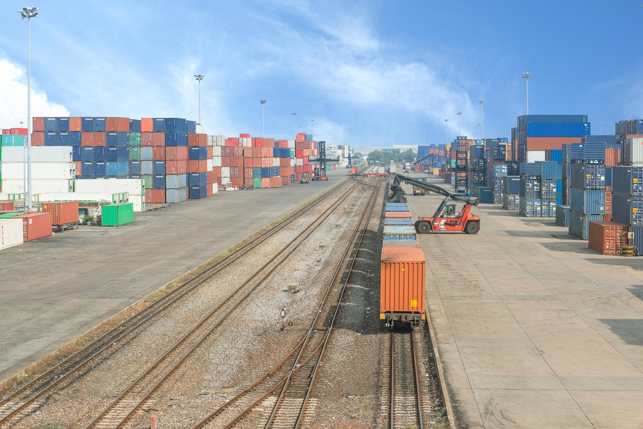 Loading intermodal rail cars at a terminal.