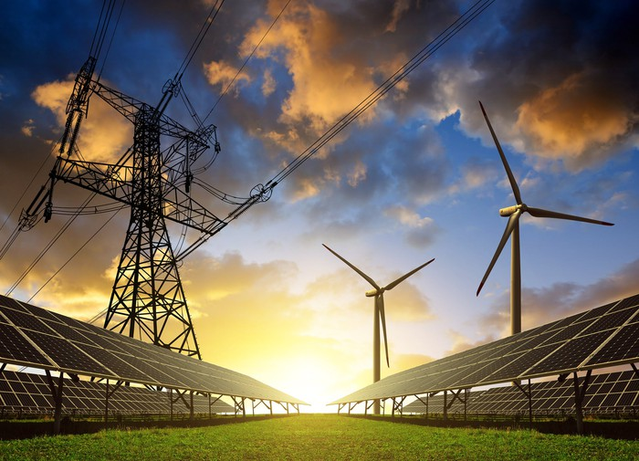 Image of powerlines, solar panels, and wind turbines