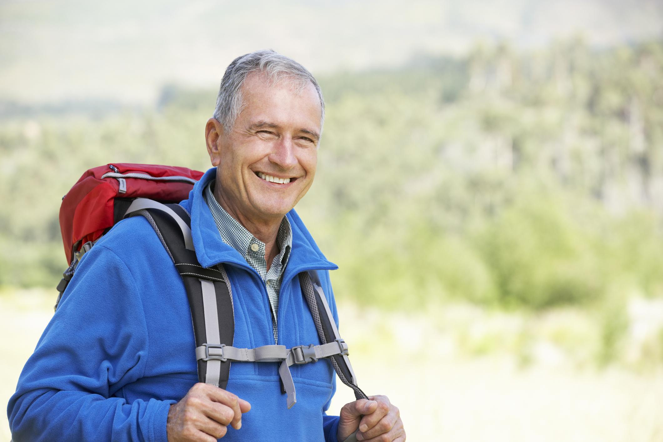 Senior man backpacking