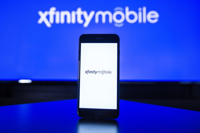 The Xfinity Mobile logo on a smartphone.