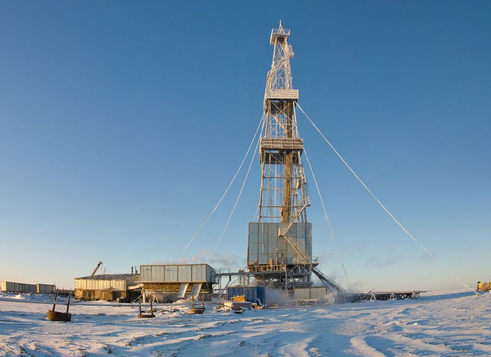 Drilling rig in snow covered field.
