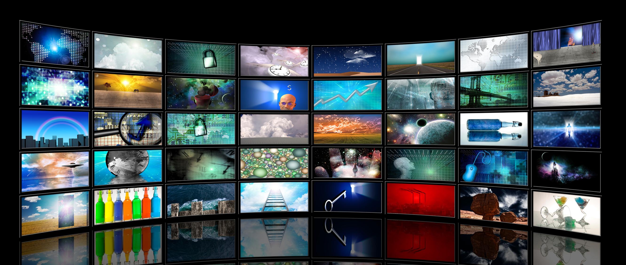 Several rows of bright TFT LCD display screens on a wall.