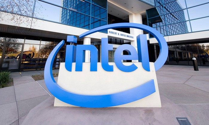 Intel's iconic logo in the form of a large, blue statue in front of abuilding on the company's HQ campus.