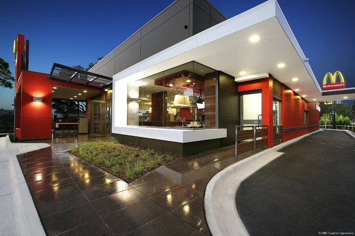 Modern and stylish exterior of Sydney domestic airport McDonald's at twilight.